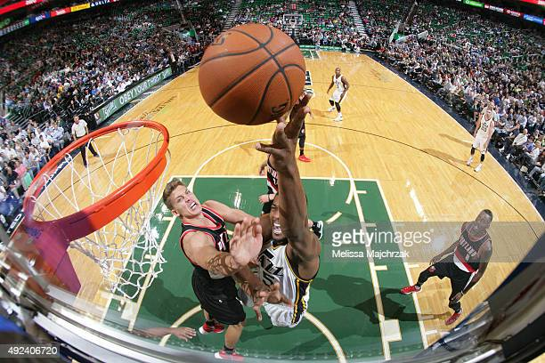 Rodney Hood of the Utah Jazz hooks the shot against Meyers Leonard of the Portland Trail Blazers during a preseason game at EnergySolutions Arena on...