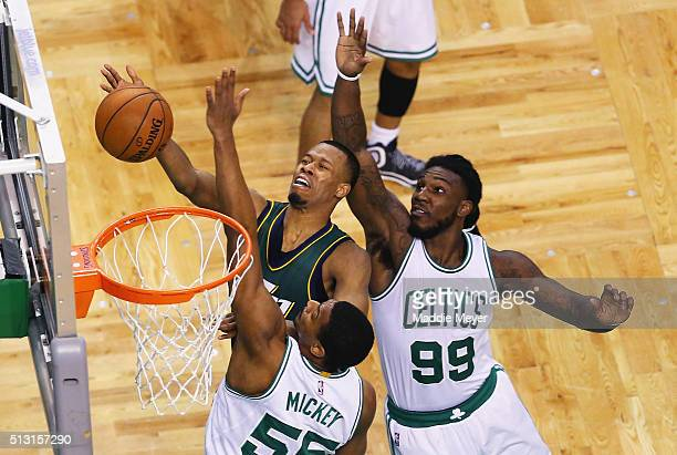 Rodney Hood of the Utah Jazz takes a shot against Jordan Mickey of the Boston Celtics and Jae Crowder during the second quarter at TD Garden on...