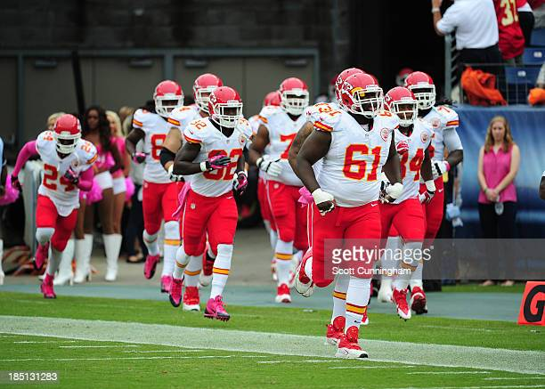 Rodney Hudson of the Kansas City Chiefs leads the team on to the field before the game against the Tennessee Titans at LP Field on October 6 2013 in...