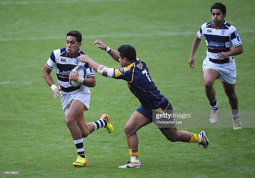 Rodney Iona of Brumbies reaches out to try and tackle Kali Hala of Auckland during the Cup Final match between ACT Brumbies and Auckland of the World Club 7's 2013 at Twickenham Stadium on August 18, 2013 in London, England.