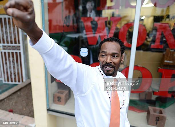 Rodney King gestures prior to the presentation of his autobiographical book 'The Riot Within...My Journey from Rebellion to Redemption' at the Eso...