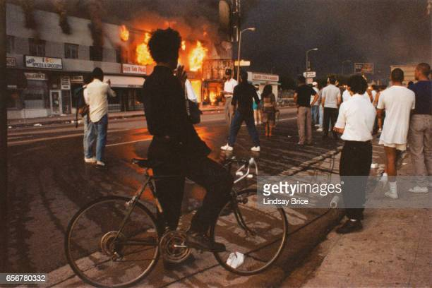 Rodney King Riot A view of businesses beginning to burn on Pico Boulevard near Hayworth Avenue onlookers gathering a young man dressed in black...