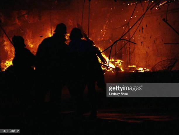 Rodney King Riot. A view of intersection of Pico Boulevard and Hayworth Avenue during the Rodney King Riots showing firemen silhouetted against...