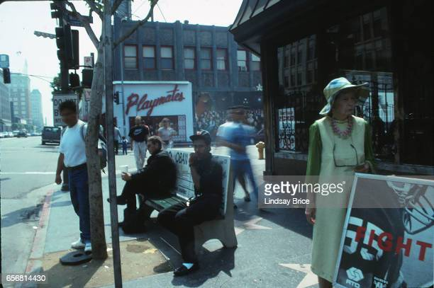 Rodney King Riot Angelenos venturing out on Hollywood Boulevard the morning after looting and burning of local businesses in the Rodney King Riot The...