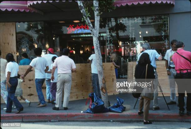 Rodney King Riot. Onlookers gathering the morning after fires and looting during the Rodney King Riots reached Hollywood Boulevard watching...