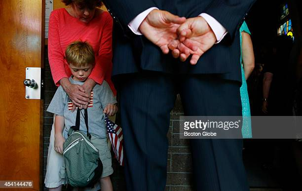 Rodney Kondrowski stands with his grandmother Patty Chesser during a Healing Hope and for Peace mass held for slain journalist James Foley at Our...