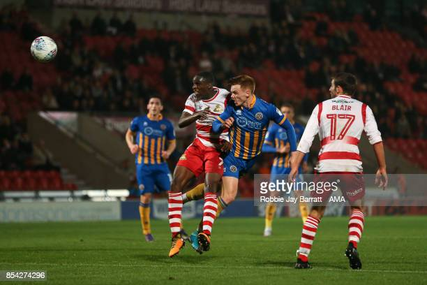 Rodney Kongolo of Doncaster Rovers and Joe Nolan of Shrewsbury Town during the Sky Bet League One match between Doncaster Rovers and Shrewsbury Town...