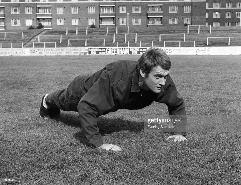 Rodney Marsh, the English footballer who plays for Manchester City, doing press-ups on the football pitch.