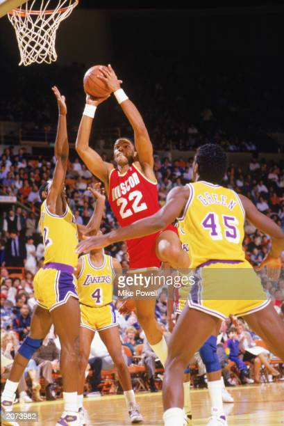 Rodney McCray of the Houston Rockets goes to the basket during a game in the198788 season against the Los Angeles Lakers at the Forum in Inglewood...