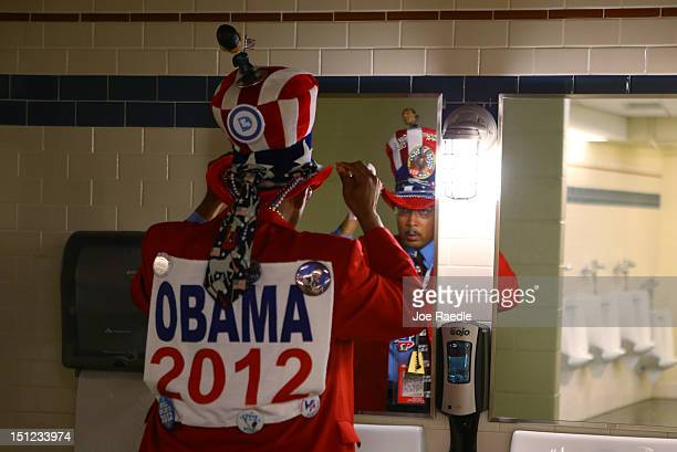 Rodney McFarland of Monroe, LA adjusts his patriotic hat in the bathroom during day one of the Democratic National Convention at Time Warner Cable...