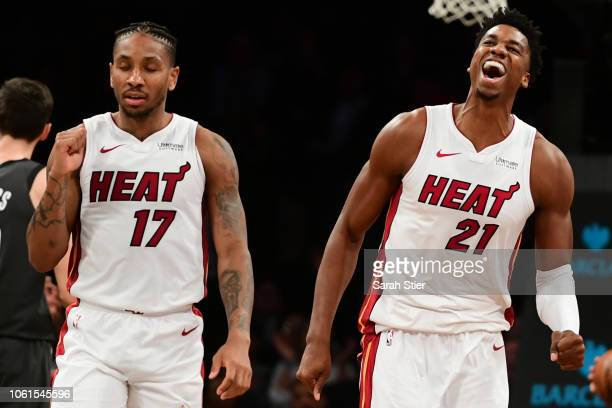 Rodney McGruder and Hassan Whiteside of the Miami Heat react after the Heat score in the final moments of the fourth quarter during the game against...