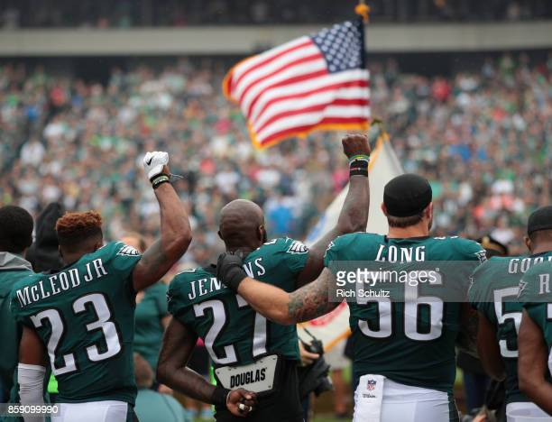 Rodney McLeod Malcolm Jenkins and Chris Long of the Philadelphia Eagles stand during the National Anthem during the first quarter at Lincoln...