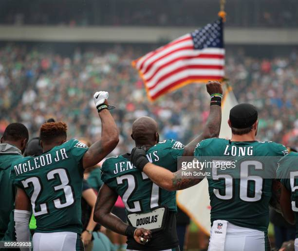 Rodney McLeod Malcolm Jenkins of the Philadelphia Eagles raise their fists in protest during the playing of the National Anthem as teammate Chris...