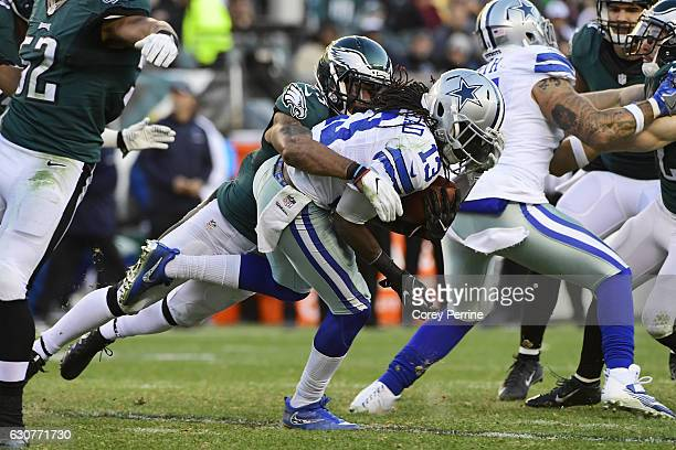 Rodney McLeod of the Philadelphia Eagles tackles Lucky Whitehead of the Dallas Cowboys during the fourth quarter at Lincoln Financial Field on...