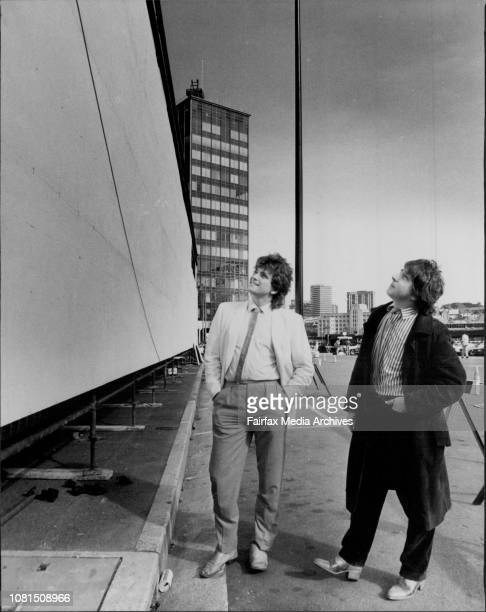 Rodney Monk and David Humphries at the Opera house next to the white board which is were they will coordinate the painting of a mural July 7 1983