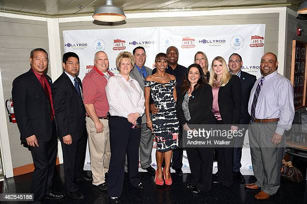 Rodney Peete and Holly Robinson Peete with the team from Walgreens attend the Autism Speaks and HollyRod Foundation Super Kid Honors 2015 at Joe's...