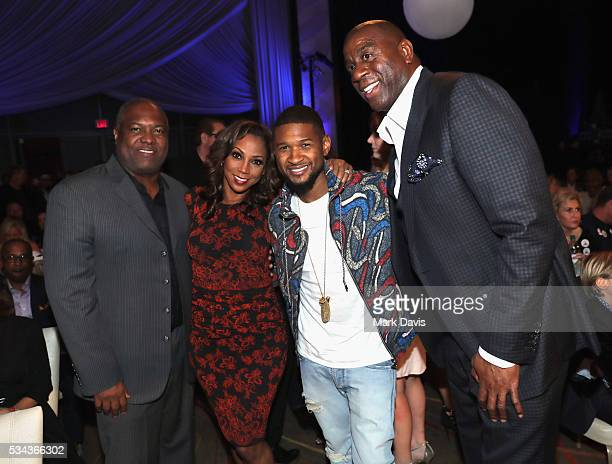 Rodney Peete Holly Robinson Peete Usher and Magic Johnson attend B Riley Co and Sugar Ray Leonard Foundation's 7th Annual Big Fighters Big Cause...