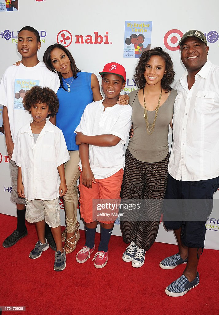 Rodney Peete Jr., Roman Peete, Holly Robinson Peete, Robinson Peete, Ryan Elizabeth Peete and Rodney Peete arrive at HollyRod Foundation's 4th Annual 'My Brother Charlie' Carnival at Culver Studios on August 3, 2013 in Culver City, California.