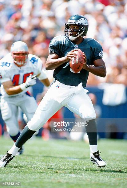 Rodney Peete of the Philadelphia Eagles drops back to pass against the New England Patriots during an NFL Football game circa 1996 at Foxboro Stadium...