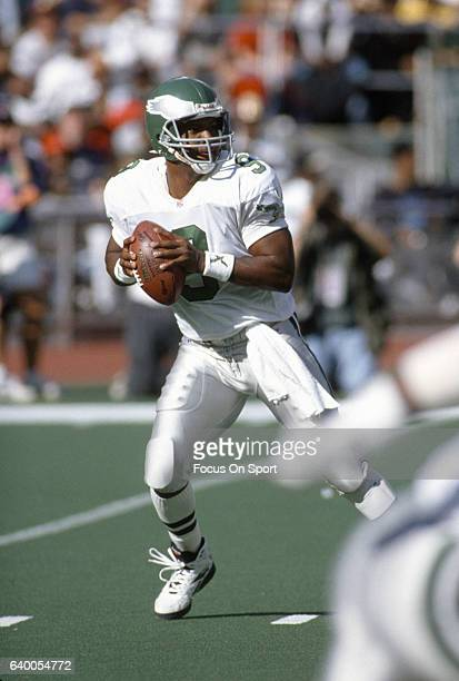 Rodney Peete of the Philadelphia Eagles drops back to pass against the Washington Redskins during an NFL Football game October 8 1995 at Veterans...