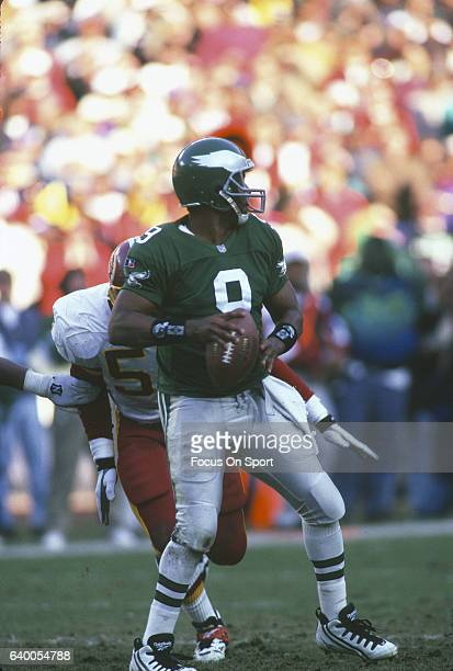 Rodney Peete of the Philadelphia Eagles drops back to pass against the Washington Redskins during an NFL Football game November 26 1995 at RFK...