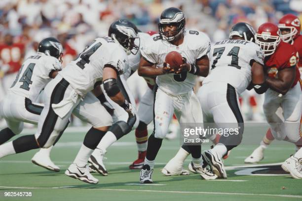 Rodney Peete Quarterback for the Philadelphia Eagles prepares to throw a pass during the National Football Conference East game against the Kansas...