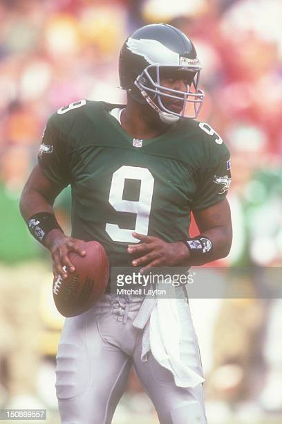 Rodney Peete the Philadelphia Eagles looks to throw a pass during a football game against the Washington Redskins on November 26 1995 at RFK Stadium...
