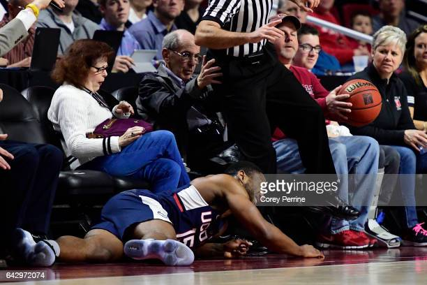 Rodney Purvis of the Connecticut Huskies crashes into fans trying to capture a loose ball against the Temple Owls during the first half at the...