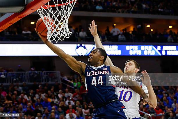 Rodney Purvis of the Connecticut Huskies shoots against Sviatoslav Mykhailiuk of the Kansas Jayhawks in the first half during the second round of the...