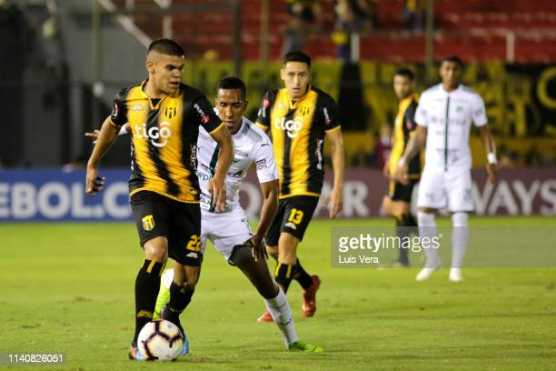 Rodney Redes of Guarani fights for the ball with John Mosquera of Deportivo Cali during a match between Guarani and Deportivo Cali as part of the...
