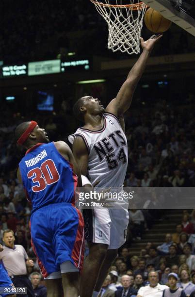 Rodney Rogers of the New Jersey Nets goes for a layup past Clifford Robinson of the Detroit Pistons in Game Four of the Eastern Conference Finals...
