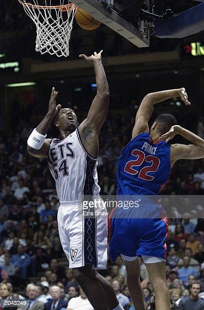 Rodney Rogers of the New Jersey Nets puts up a shot against Tayshaun Prince of the Detroit Pistons in Game Four of the Eastern Conference Finals...