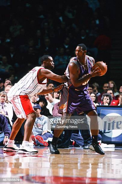 Rodney Rogers of the Phoenix Suns moves the ball against Kenny Thomas of the Houston Rockets during the game on November 18 2000 at Compaq Center in...