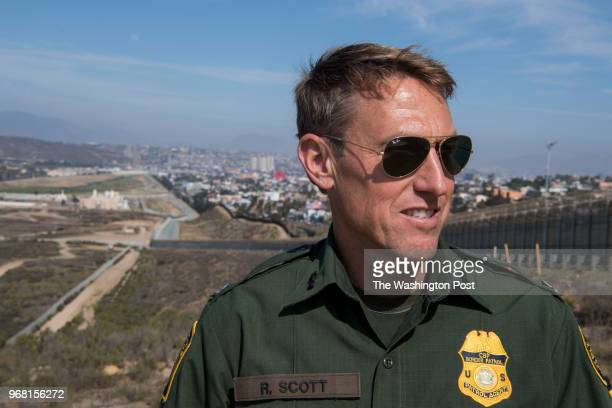 Rodney Scott, chief of the Border Patrol's San Diego sector, stands for a portrait near the border wall on April 25, 2018 in San Diego, California.