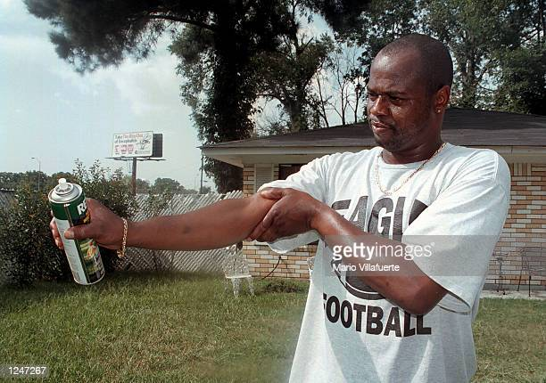 Rodney Siller rubs mosquito repellent on his arm on August 2 2002 in Monroe Louisiana The first human case of the West Nile virus was confirmed by...