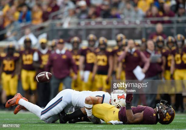 Rodney Smith of the Minnesota Golden Gophers fumbles the ball while being tackled by Bennett Williams of the Illinois Fighting Illini during the...