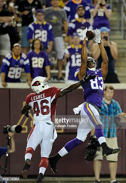 Rodney Smith of the Minnesota Vikings makes a catch of the ball for a touchdown against Jimmy Legree of the Arizona Cardinals during the fourth...