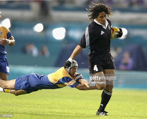 Rodney So'oialo of New Zealand breaks away during the New Zealand v Niue Island match during the pool matches Rugby 7's event at the City of...