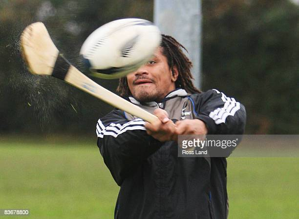 Rodney So'oialo of the All Blacks hits a rugby ball with a hurling stick during a multisports Grassroots Clinic with Munster rugby players as well as...