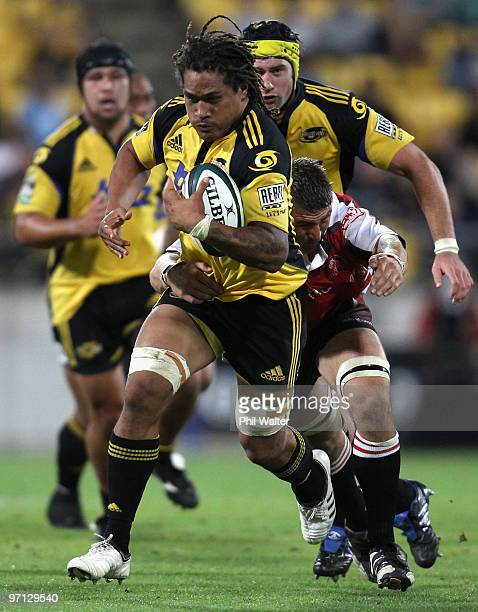 Rodney So'oialo of the Hurricanes breaks away from the tackle of Karl Lowe of the Lions during the round three Super 14 match between the Hurricanes...