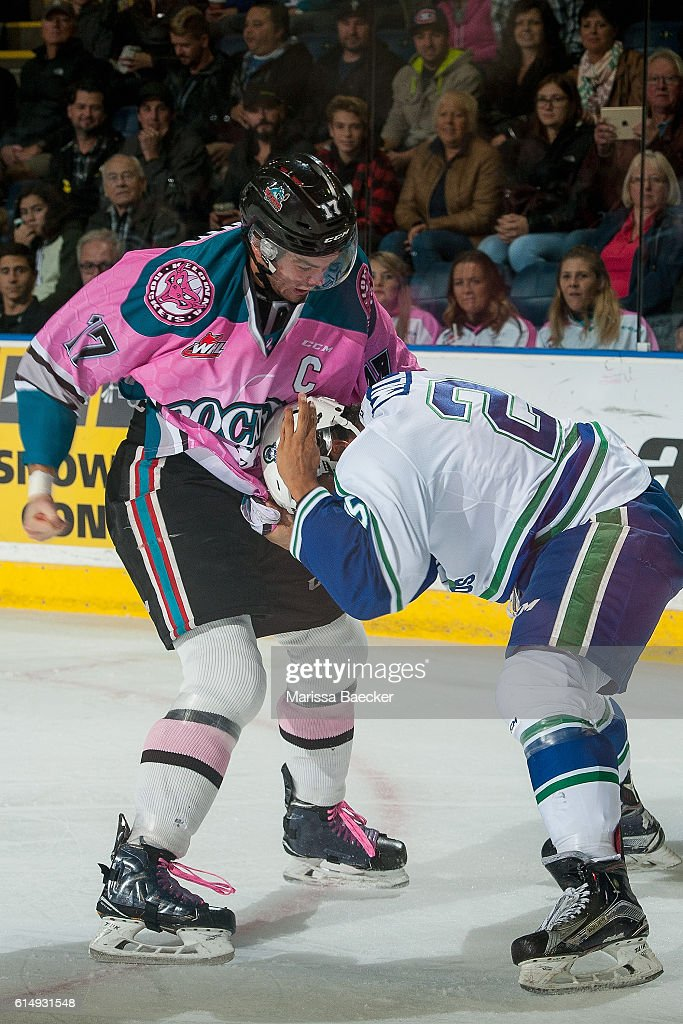 Rodney Southam #17 of Kelowna Rockets drops the gloves with Arthur Miller #25 of Swift Current Broncos on October 15, 2016 at Prospera Place in Kelowna, British Columbia, Canada.