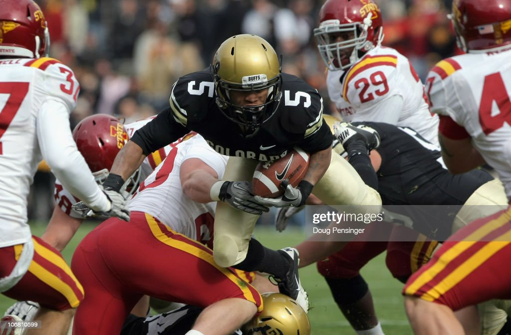 Rodney Stewart #5 of the Colorado Buffaloes leaps through the Iowa State Cyclones defense as he gains yardage at Folsom Field on November 13, 2010 in Boulder, Colorado. Colorado defeated Iowa State 34-14.