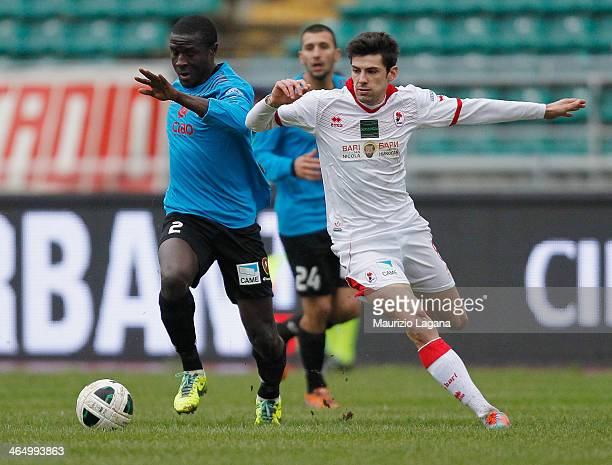 Rodney Strasser of Reggina competes for the ball with Daniele Sciaudone of Bari during the Serie B match between AS Bari and Reggina Calcio at Stadio...