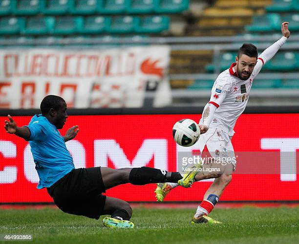 Rodney Strasser of Reggina competes for the ball with Marco Romizi of Bari during the Serie B match between AS Bari and Reggina Calcio at Stadio San...