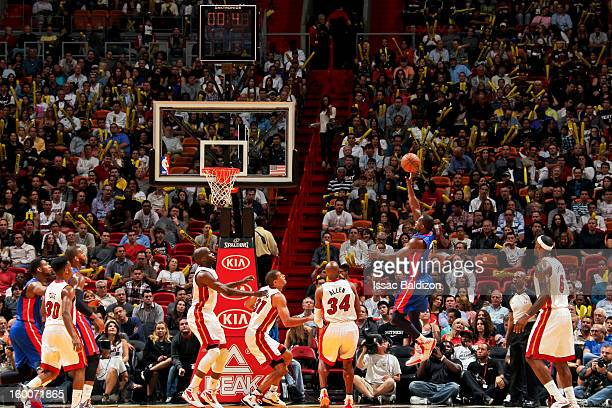 Rodney Stuckey of the Detroit Pistons attempts a shot as the clock winds down against the Miami Heat on January 25 2013 at American Airlines Arena in...