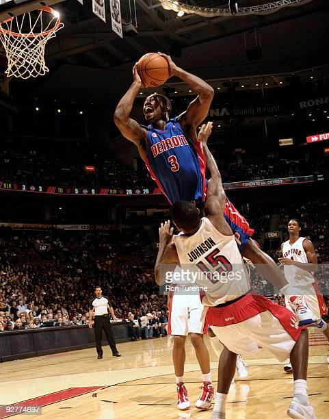Rodney Stuckey of the Detroit Pistons drives hard to the basket and draws the foul from Amir Johnson of the Toronto Raptors during a game on November...
