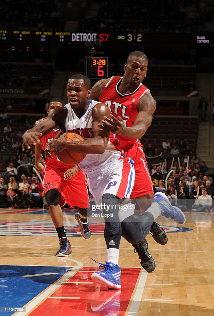 Rodney Stuckey #3 of the Detroit Pistons runs with the ball against Ivan Johnson #44 of the Atlanta Hawks during the game on March 9, 2012 at The Palace of Auburn Hills in Auburn Hills, Michigan.