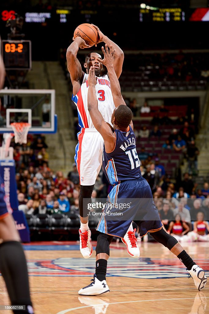Rodney Stuckey #3 of the Detroit Pistons shoots a three-pointer against Kemba Walker #15 of the Charlotte Bobcats on January 6, 2013 at The Palace of Auburn Hills in Auburn Hills, Michigan.