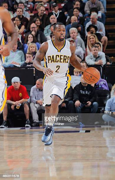 Rodney Stuckey of the Indiana Pacers brings the ball up the court against the Indiana Pacers on December 5 2014 at Sleep Train Arena in Sacramento...