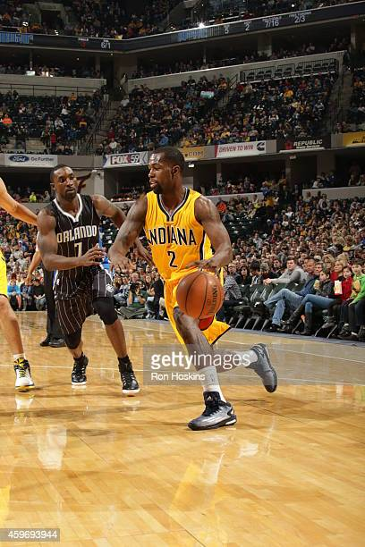 Rodney Stuckey of the Indiana Pacers handles the ball against the Orlando Magic during the game on November 28 2014 at Bankers Life Fieldhouse in...
